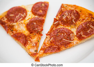 Two Slices of Pepperoni Pizza on White Plate