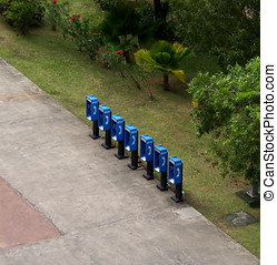 Group of blue phone booths - A grouping of empty blue pay...