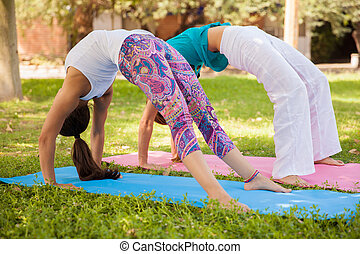 Girls arching their backs - Young women stretching and...