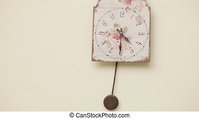 Wall clock - Hanging on a wall clock with pendulum