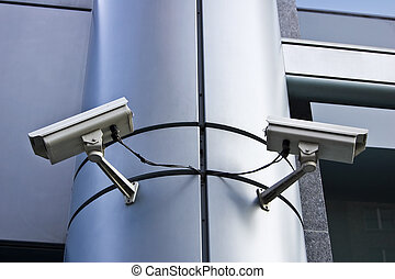 Security Cameras - Two big exterior security cameras pointed...