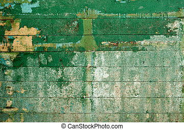Green surface of the old wall covered with boards - Green...