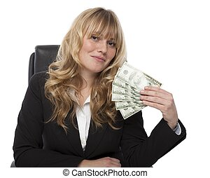 Businesswoman fanning herself with money - Successful...