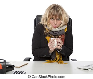 Freezing businesswoman warming up with coffee - Freezing...