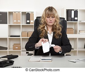 Young businesswoman tearing up a document - Young...
