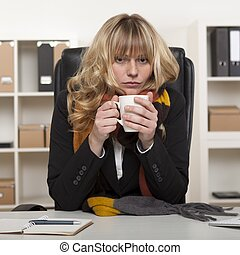 Young girl at work enjoying hot coffee - Young girl at work...