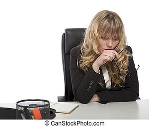Young businesswoman deep in thought holding her glasses in...