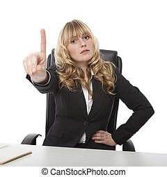 Manageress admonishing a junior employee waving her finger...