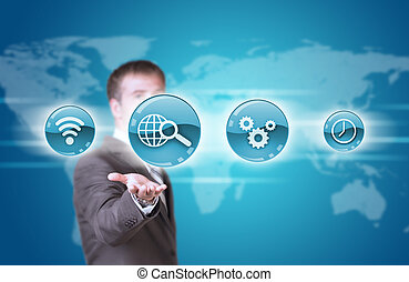 Business man hold blue application icons in hand. World map...