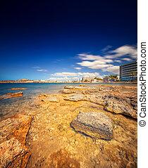 Paradise beach in Ibiza island with blue sky