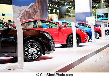 cars in a showroom - The image of cars in a showroom