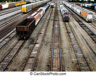 View of many railroad tracks with cars