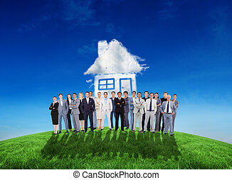 Composite image of business people standing up against cloud...