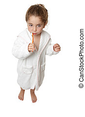 Girl brushing her teeth with toothbrush - A small toddler...