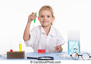 Chemist with green liquid in a test tube - Pupil at a school...