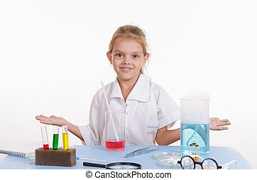 Chemist girl in chemistry class - Pupil at a school desk in...