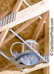 Electrical exposed in a house under construction - Can light...