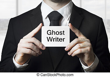 businessman holding sign ghost writer plagiarism
