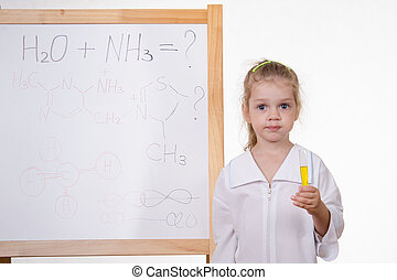Chemist with test tube at the blackboard