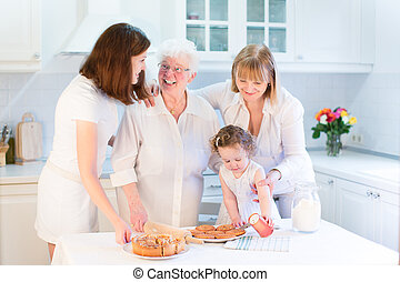 Grandmother baking an apple pie with her daughter, granddaughter