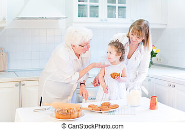 Grandmother having fung with her daughter and granddaughter - a