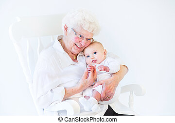 Beautiful grandmother singing to her newborn baby grandson...