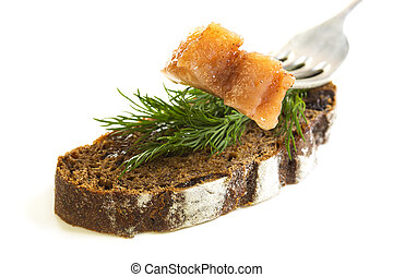 Slice on a fork herring and black bread.
