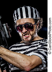 Manifestation Prison riot concept Man holding a machine gun,...