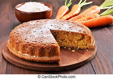 Carrot cake on wooden table