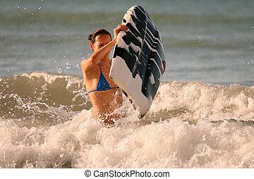 Surfer in ocean - Bikini Girl with boogie board in the water