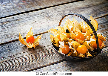 physalis on a dark wood background toning selective focus on...