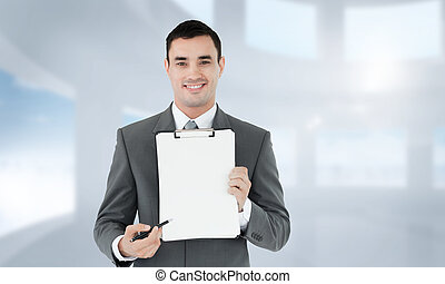 Composite image of businessman pointing with pen on...