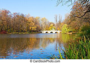 autumn park Lazienki, Warsaw - autumn park with trees over...