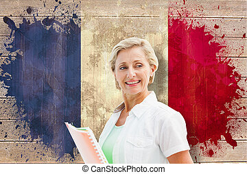 Composite image of mature student smiling - Mature student...