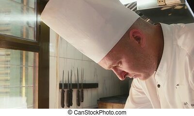 Cook in restaurant kitchen, chef