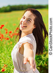 laughing young woman on poppy field - happiness, nature,...