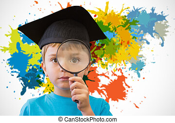 Composite image of cute pupil looking through magnifying...
