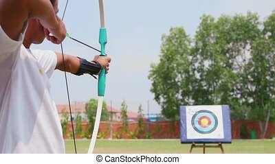 Young man training at archery, bow - Young man training at...
