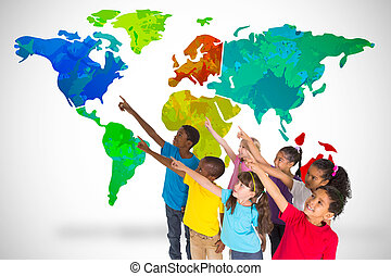 Elementary pupils pointing against white background with...