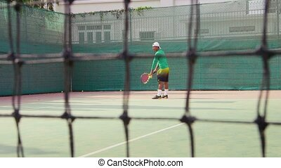 Man playing tennis, game, sports - Young people and leisure,...