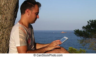 Browsing Tablet Next to the Sea