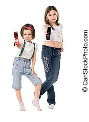 Two girls - Two little girls with mobile phones isolated...