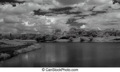 InfraRed landscape: Movement of clouds over the reservoir....