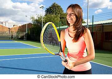 young woman playing tennis.