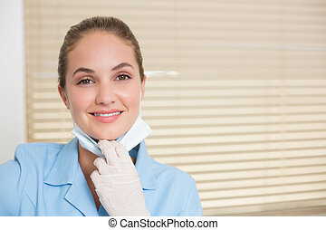 Dental assistant smiling at camera at the dental clinic