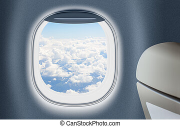 Aeroplane or jet window with clouds behind, traveling...