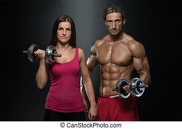Fitness Couple Exercise Biceps - Strong Young Couple Working...
