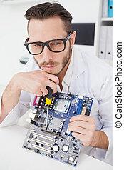 Computer engineer working on broken cpu