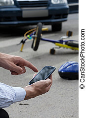 Calling an ambulance after road accident - Close-up of...