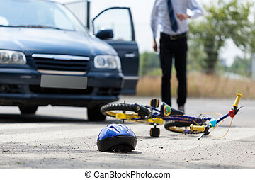 Road accident - Close-up of a childrens bike and helmet...